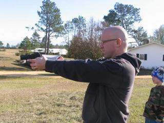 Gene shooting thepistol