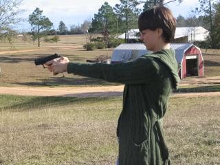 Lisa shooting thepistol